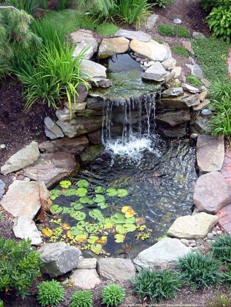 Building a small koi pond waterfall.-504094da200f08d5160c42e8602623aa-jpg