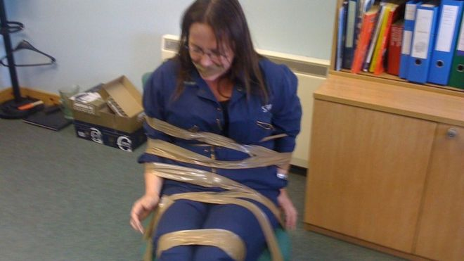 Sticky tape bondage in fisheries office....-bondage-jpg