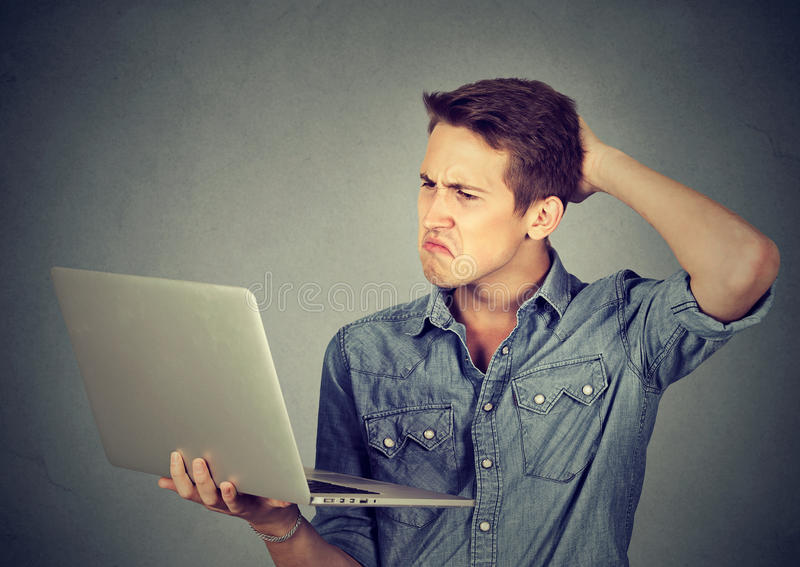 Posting pictures-funny-clueless-guy-having-troubles-laptop