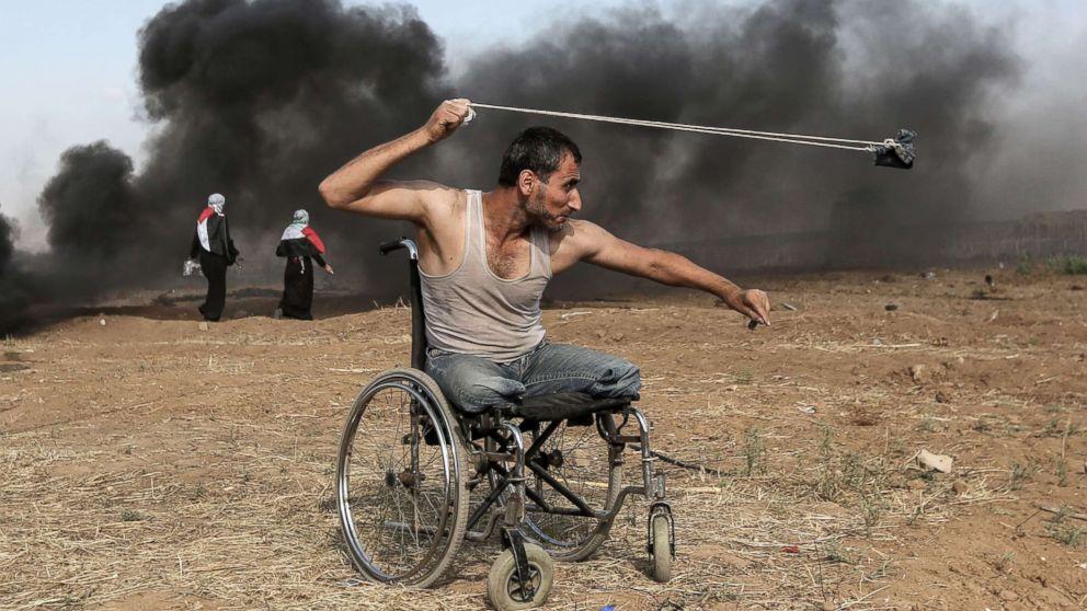 Israeli army kills 17 Palestinians in Gaza protests-palestine-israel-gaza-conflict-stonethrower-wheelchair